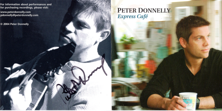Express Cafe cover, signed